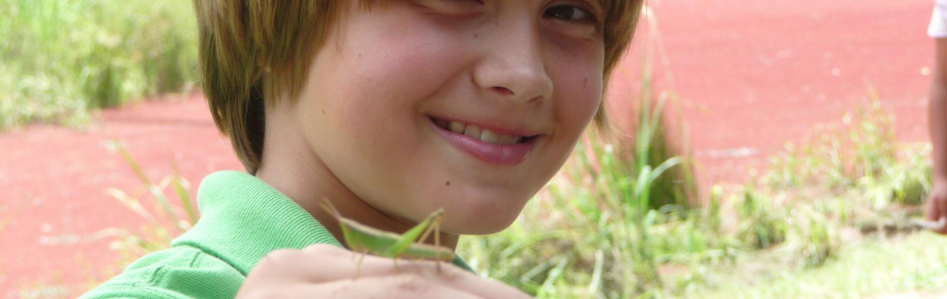 Child with grashopper